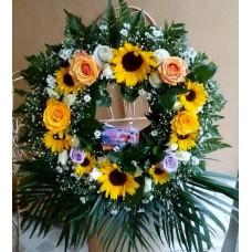 Arreglos Funebre en Corona de Madera con Flores Variadas